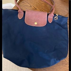 Longchamp navy with brown leather straps handbag